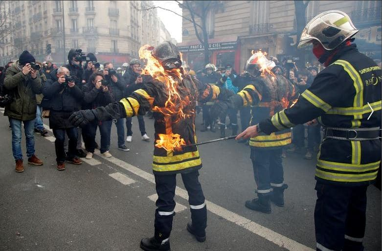 Photo of To Protest Macron's Economic Policies French Firefighters Light Themselves Up On Fire